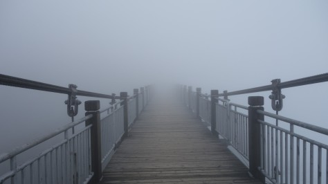 Bridge fading into the mist